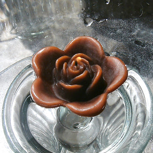 chocolate brown colored rose shaped floating candle for wedding reception centerpieces