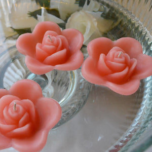 coral reef colored rose shaped floating candle for wedding reception centerpieces