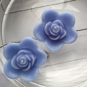 dusty blue colored rose shaped floating candle for wedding reception centerpieces