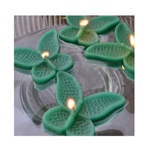 set of eight emerald green butterfly shaped floating wedding candles for reception centerpieces