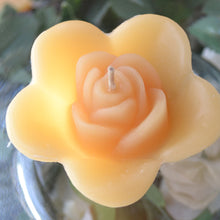 Load image into Gallery viewer, golden honey colored rose shaped floating candle for wedding reception centerpieces