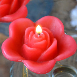 guava colored rose shaped floating candle for wedding reception centerpieces