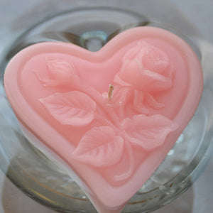 light pink blush floating heart candle with rose motif for wedding reception centerpieces