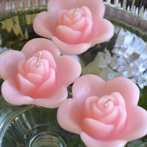 light pink blush colored rose shaped floating candle for wedding reception centerpieces