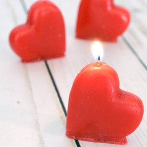 set of four mini red heart candles for valentines day, birthdays, cupcake topper