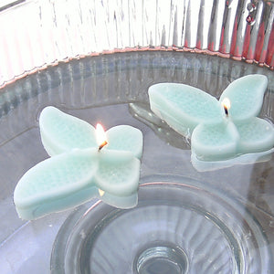 set of eight mint green butterfly shaped floating wedding candles for reception centerpieces