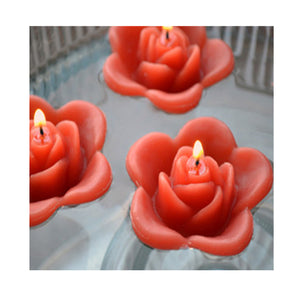 rust orange fall autumn colored rose shaped floating candle for wedding reception centerpieces