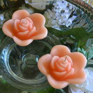 peach colored rose shaped floating candle for wedding reception centerpieces