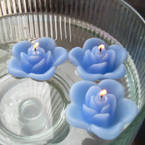 periwinkle blue colored rose shaped floating candle for wedding reception centerpieces