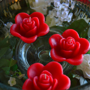 red colored rose shaped floating candle for wedding reception centerpieces