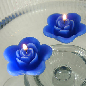 royal blue colored rose shaped floating candle for wedding reception centerpieces