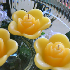 sun yellow colored rose shaped floating candle for wedding reception centerpieces