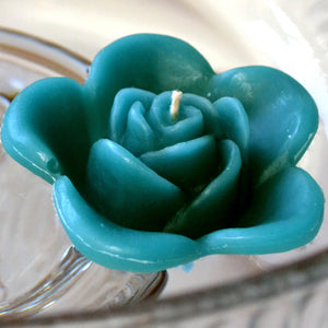 teal blue colored rose shaped floating candle for wedding reception centerpieces