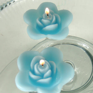 turquoise blue colored rose shaped floating candle for wedding reception centerpieces