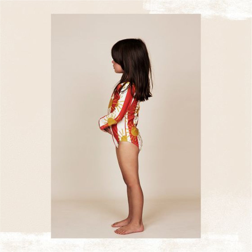 d678199cdc Off White Sun Stripe Long Sleeve Swimsuit by Mini Rodini