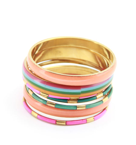 stack of bangles in neon