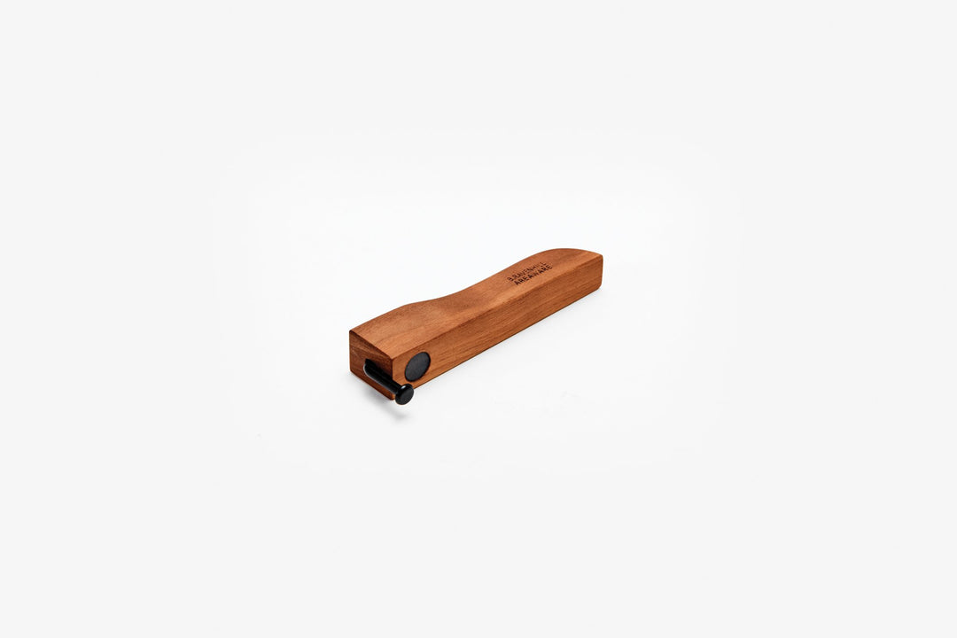 Areaware's Walnut Bent Nail Bottle Opener