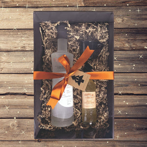Wrapped gift box with 70cl bottle of Ogilvy vodka, 200ml bottle of ginger beer, small black enamel mug and copper pourer