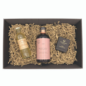 Contents of gift box with 50cl bottle of Perfect Pour cocktail mix in bramble & rhubarb flavour with a bottle of ginger beer and a Gold Hart 'Glen' candle