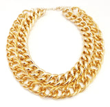 "Double layered chunky chain necklace in polished gold tone metal.  • 16"" L  