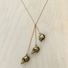 Evolution Skull Brass Necklace