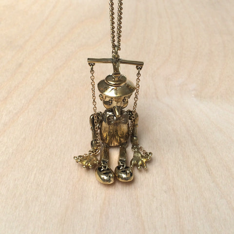 Pinnochio Brass Necklace