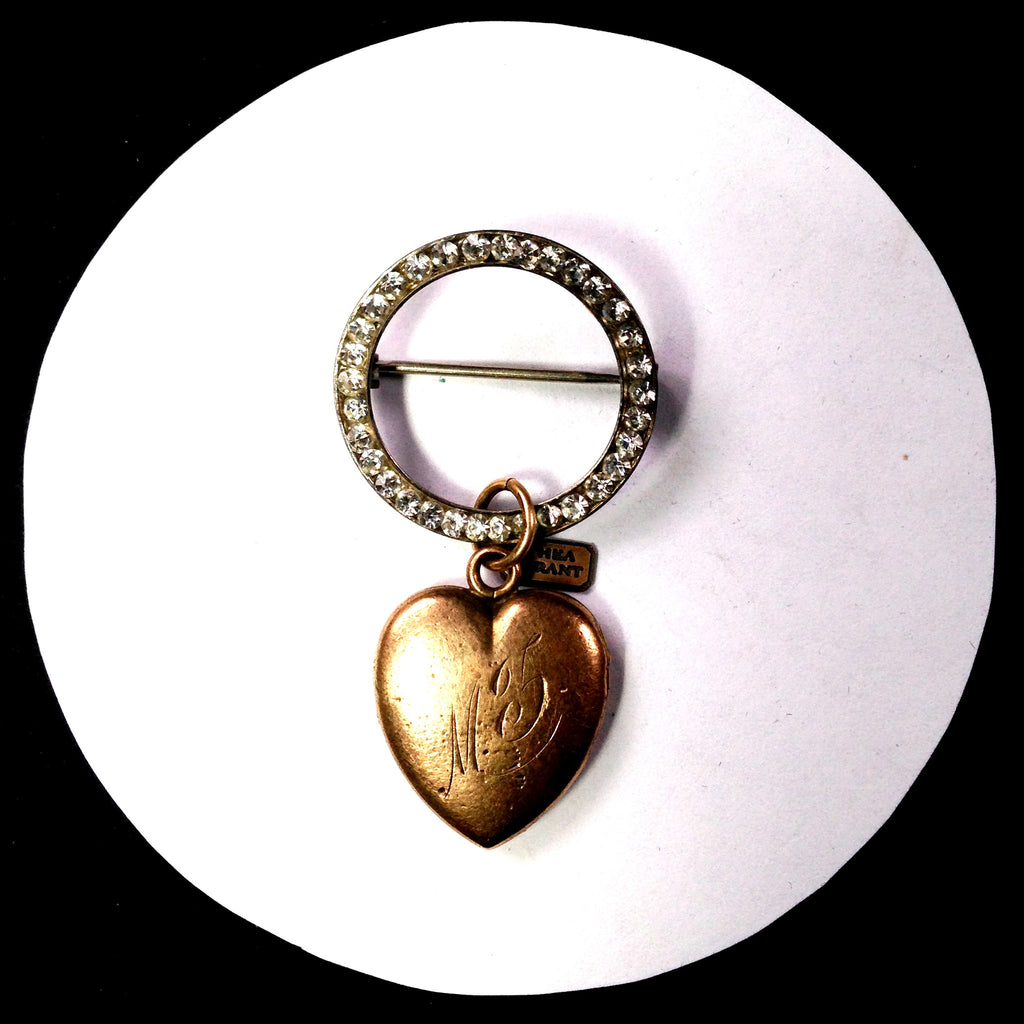 Rhinestone circle pin with a Victorian gold-filled heart locket pendant.