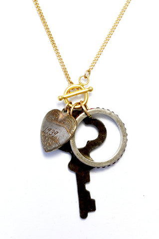 Key, heart and ring triple charm necklace