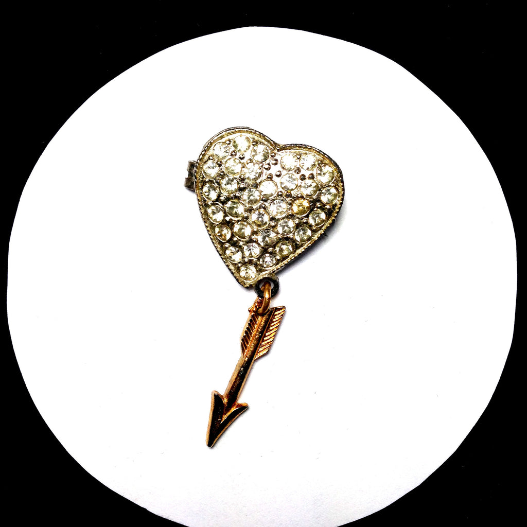 Art Deco vintage pave rhinestone heart pin with dangling arrow at tip. FRONT VIEW.