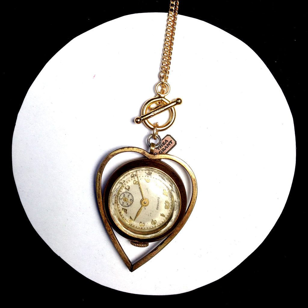 JENNINGS Ca. 1940 heart framed gold-filled watch charm necklace.