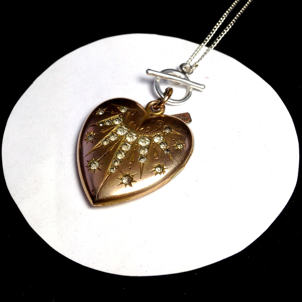 Large Victorian gold-filled star-pattern locket on silver chain necklace.