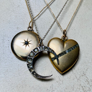 Antique crystal lockets, heart, moon, star.