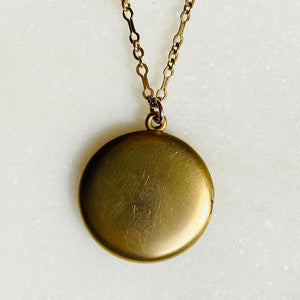 Plain matte gold-shell round Victorian locket necklace