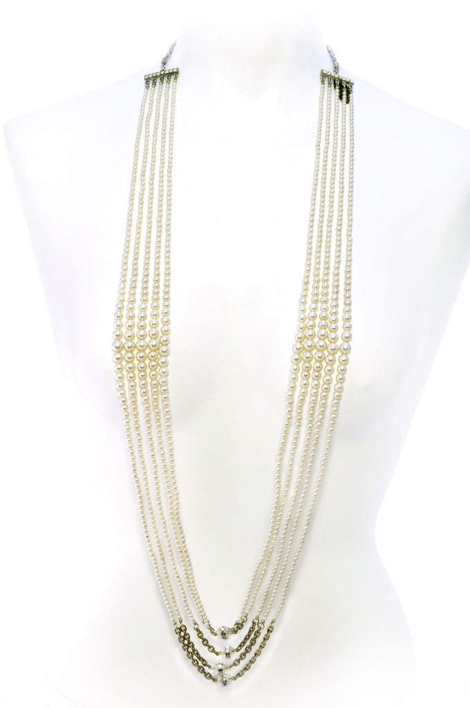 Long faux pearl reversible necklace with rhinestone segments.Front