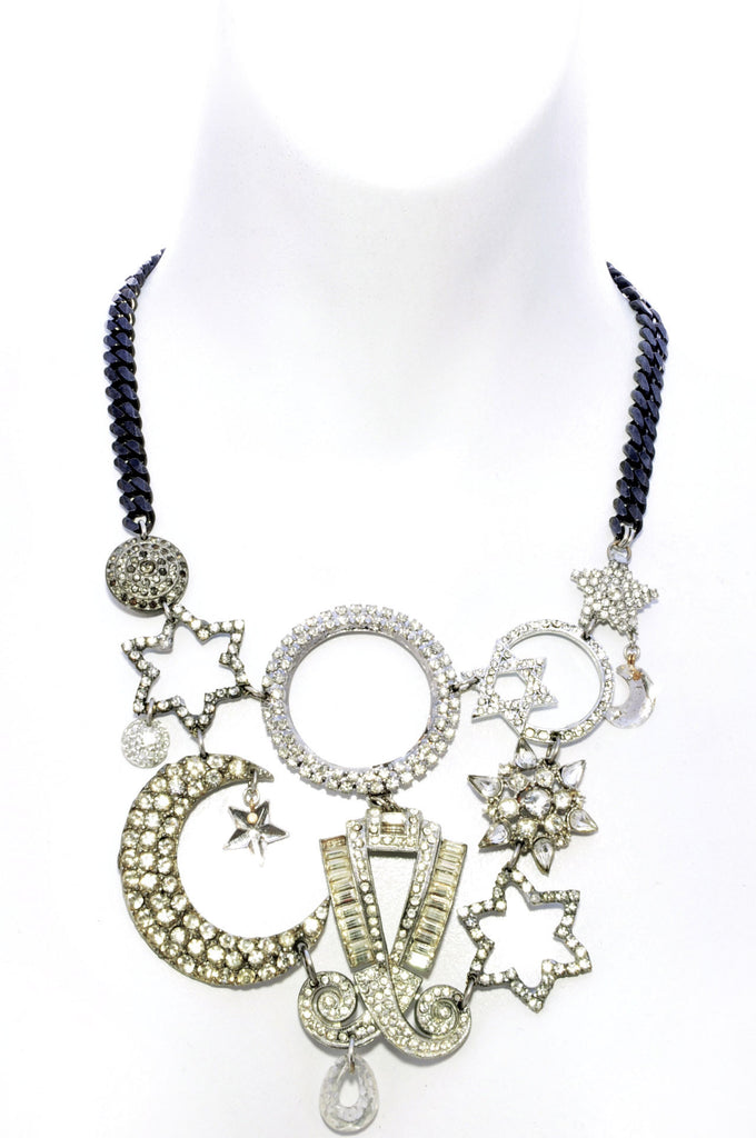 Stars, moons, celestial shapes paste, crystal, rhinestone collage bib necklace.Front