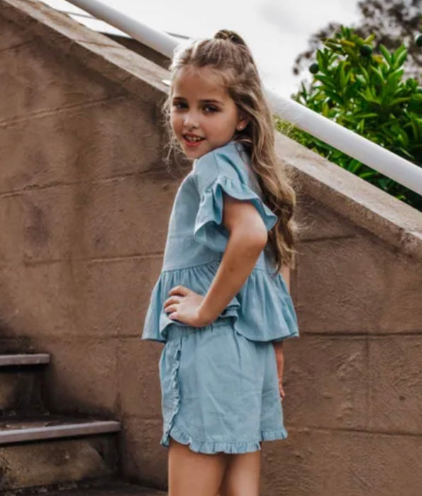 LITTLE HEARTS CO FRILLY PEPLUM TOP - CHAMBRAY