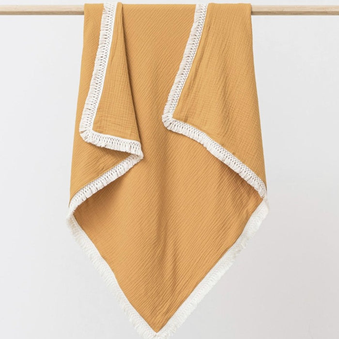 OVER THE DANDELIONS MUSLIN BLANKET TASSEL TRIM - SAFFRON