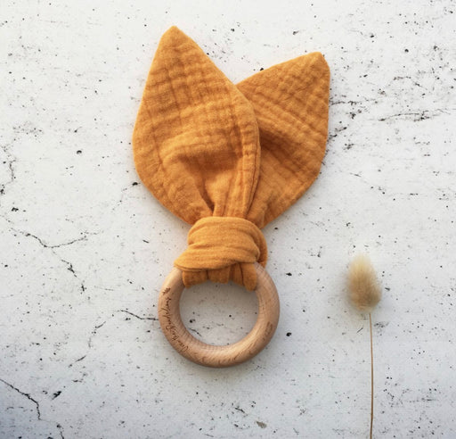 OVER THE DANDELIONS MUSLIN BUNNY EARS TEETHER - SAFFRON