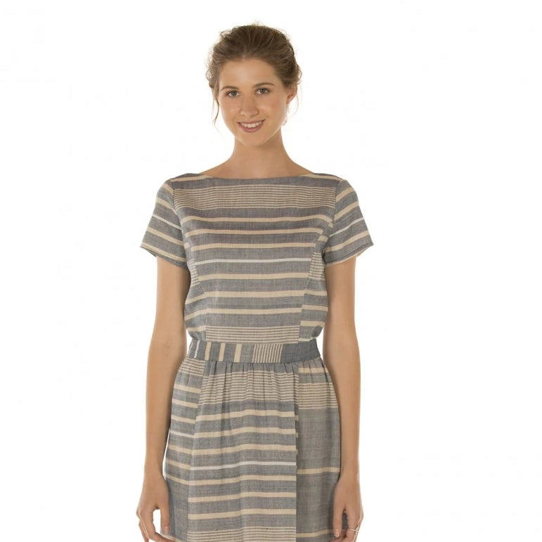 Lady in beautiful striped organic cotton knee length womens dress.