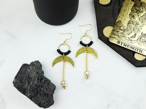 Topview of Pair of Hammered style drop macrame earrings in gold and black color