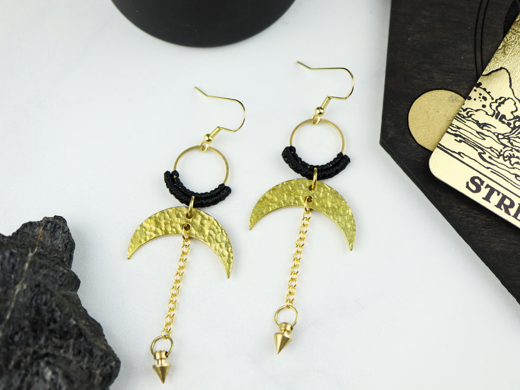 Closeup of Pair of Hammered style drop macrame earrings in gold and black color.
