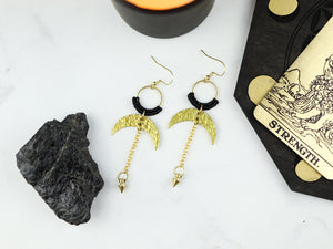 Pair of Hammered style drop macrame earrings in gold and black color.