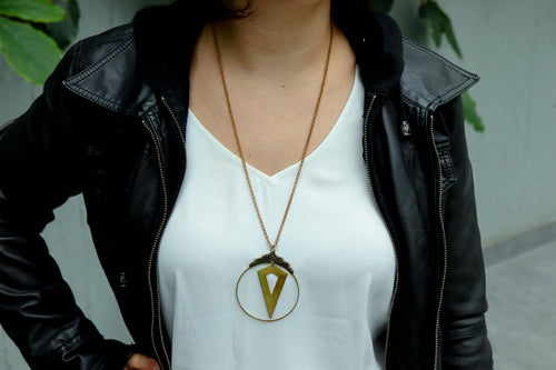 Statement arrow necklace in olive green