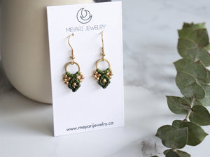 Pair of Green Arya macrame earrings made from raw brass.