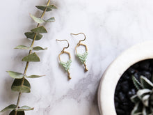 Load image into Gallery viewer, Top View of Hexagon style drop macrame earrings in green and golden color in white background.