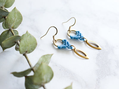Side View of Marquise style drop macrame earrings in blue and golden color.