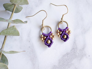 Pair of Purple Arya macrame earrings made from raw brass.