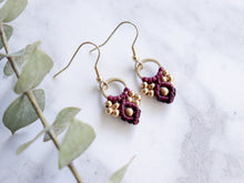Load image into Gallery viewer, Closeup Pair of wine color Arya macrame earrings made from raw brass.