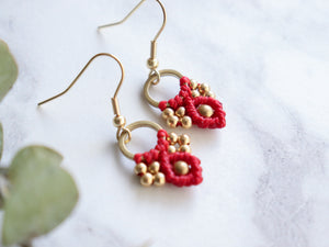 Closeup Pair of Red color Arya macrame earrings made from raw brass.