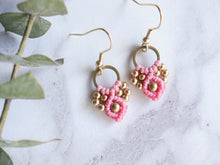 Load image into Gallery viewer, Closeup Pair of pink color Arya macrame earrings made from raw brass.